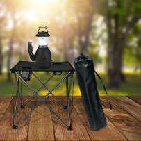 Folding table and lantern in the wilderness