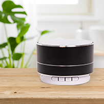 black and silver bluetooth speaker on counter